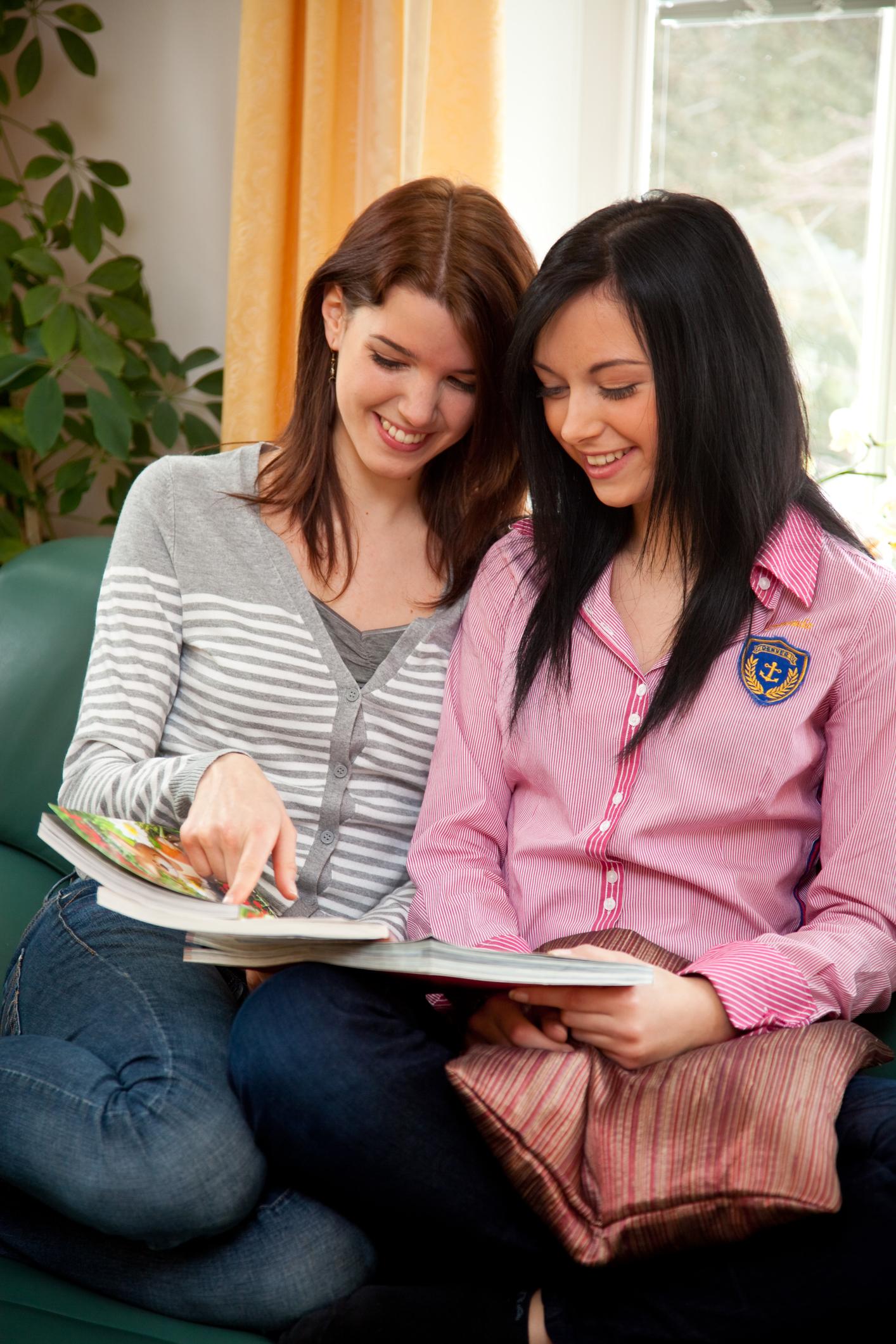 Two Girls Catalog Shopping