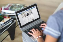 Woman on Facebook business page